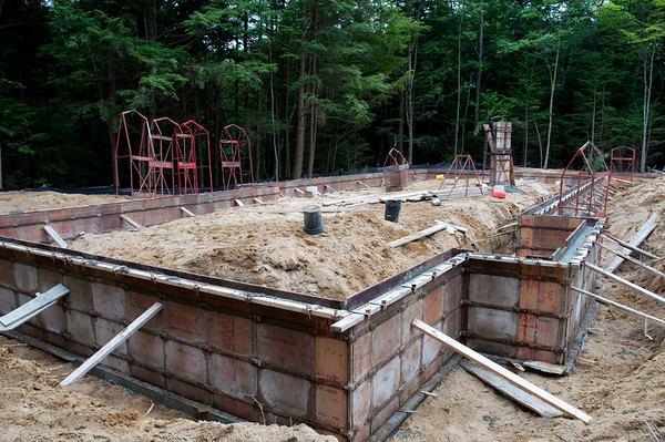 The foundation frost walls, freshly poured wet cement!