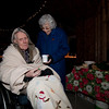 Don all bundled up, and gets a cup of hot cider from Lois