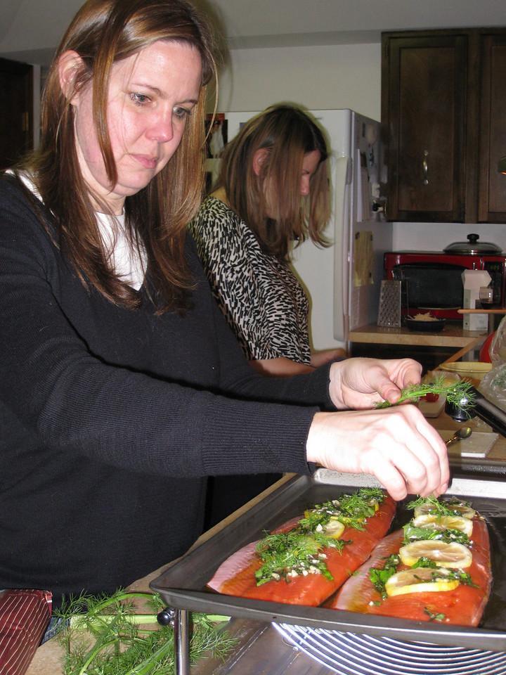 Karen working on dinner.