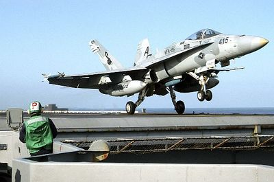 """My high school buddy, Travis, launching off of an aircraft carrier in an FA-18A """"Super Hornet"""" (I think).  Travis kicks ass.  Go Navy!"""