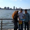 NYC- Looking at the map while viewing Hudson river.