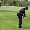 Sue in trouble off in the rough and under a tree, trying to get the 150 yds to the green.