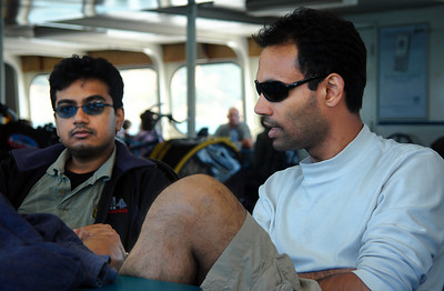 Chandi and Kiran chat inside the ferry on the way back.