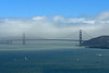 Fog begins to lift off the Golden Gate bridge.