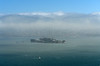 The city - barely visible under the lifting fog.