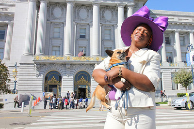 Idell Wilson with her service dog in front of San Francisco City Hall, September 27th, 2011.    Across the street, on the front steps is a press conference being hosted by three candidates for District Attorney - David Onek, Sharmin Bock and Bill Fazio regarding the current District Attorney's refusal to release all documents related to a DNA crime lab investigation.   The current DA, George Gascón, is also a competing candidate.