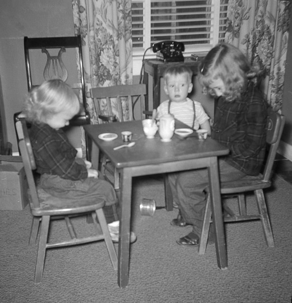 Becky with siblings Susan & Dan, praying before a tea party! (1956)