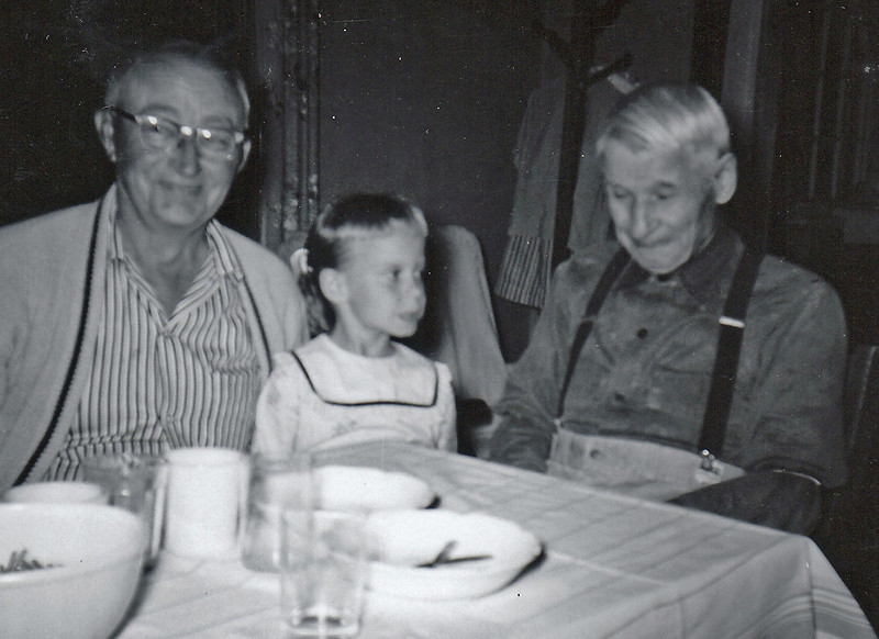 Becky at age 6 with her two grandpas - 1959?