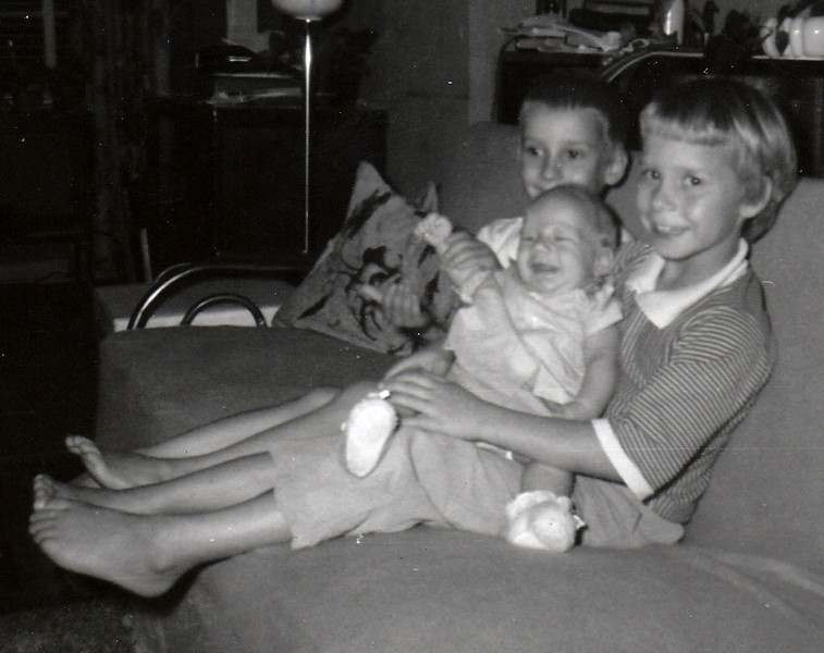 Becky at age 8, holding baby brother Joey