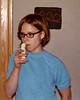 Becky munching a banana, age 18