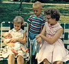 Becky with siblings, age 8, holding Joey