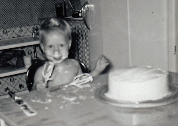 Licking the batter -- with birthday cake, age 2