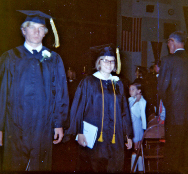 Becky at Hesston College (may be Goshen, according to the graduation colors?)