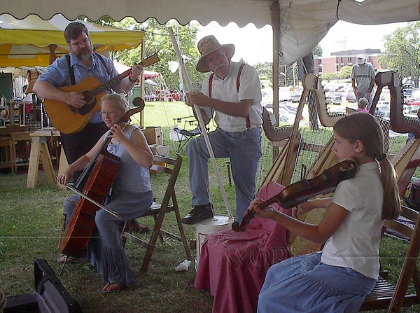 """Sally found John Kovac and his wife Judy at the Kutztown PA German Fest, and was glad we got to play music with him.  (Trudy & Lydia playing music with John at Kutztown -- John's playing his PVC """"bucket bass"""")"""