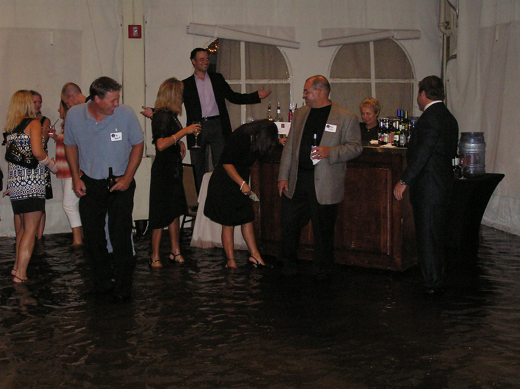 It takes more than a little water to get JFK grads away from the bar :-)