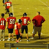 Jim Bob waiting on the sideline for his defense to stop their opponent.   He is #8.