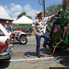 A tractor in the parade tried to help jump start the classic car.