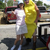 But of course, it's a banana in cowboy boots! Yes, that's me in socks; I'd gotten comfortable in my chair and rushed out so as to not miss this photo opportunity. :)