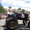 "The sign reads: ""Original 1949 Farmall (popular brand of tractor): Original parts: dirt & all!"""