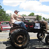 "The sign reads: ""Original 1949 Farmall (popular brand of tractor): Original parts: dirt & all!"""