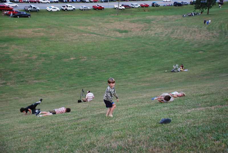 Kids roll down the hill at Rabun Gap Nacoochee School before the fireworks.