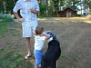 Justin watches over Will while the Wild Riley-dawg gives him some attention.   The obligatory G&T in hand.  July 4th, 2007.