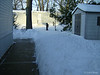My shoveled sidewalk, snow piled high.<br /> December 19, 2009 Blizzard