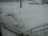 My poor little GEO Metro in the blizzard.<br /> February 6, 2010 Blizzard