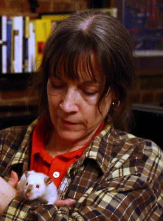 Karen Borga holding one of Dr. Anthony Pilny's pet rats.