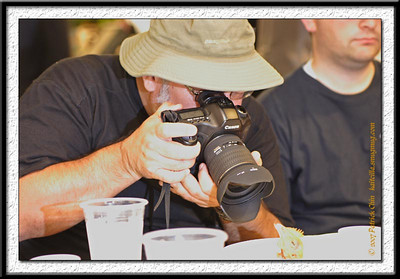 Gary taking a close up shot of a chicken head.