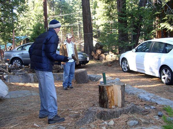 Brad splitting wood.