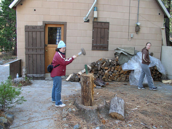 Danielle and future baby Ian splitting wood.