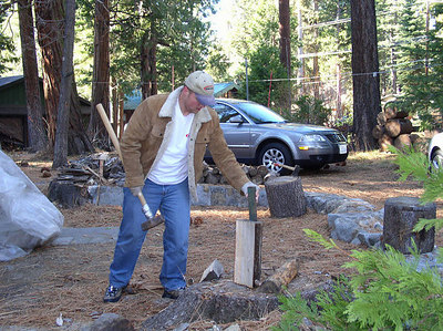 Phil splitting wood.