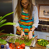 Lexie carefully arranges the asparagus to get them ready for the broiler.