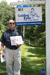 King Lion Tom Hart holding the Lions Club Growth  Award received from The Guiding Eyes for the Blind 7/16/11.