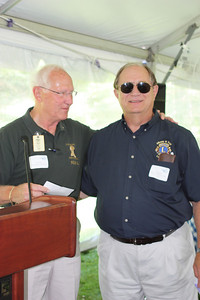 King Lion Tom Hart presenting our donation to the Guiding Eyes for the Blind to PDG Ed Klotz on   7/16/11