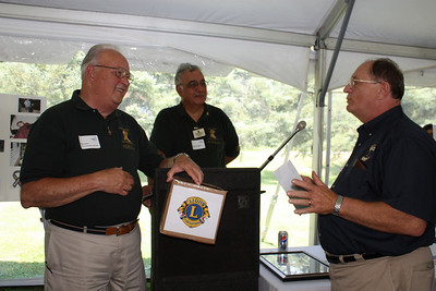 Lion Tom Hart presenting the club donation to PDG Dick Kahn and PDG Angelo Purcigliotti 7/17/10