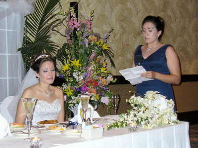 The Maid of Honor toasts her sister