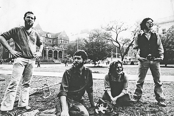 Dave Nance, Dan Schiller, Tony Smull, Rick Lozoff (w. kitten of Milton by Foxy Lady), on Library Mall; circa 1972 (photo by Dave Lewane?)