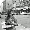 "Betsy Lawrence, on State Street; April 21, 1974 (headlines:""The Ending Begins"", ""Mr. Nixon Faces Deadlines On Two Subpoenas"")"