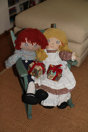 Raggedy Ann and Andy have a great spot and Christmas gifts!