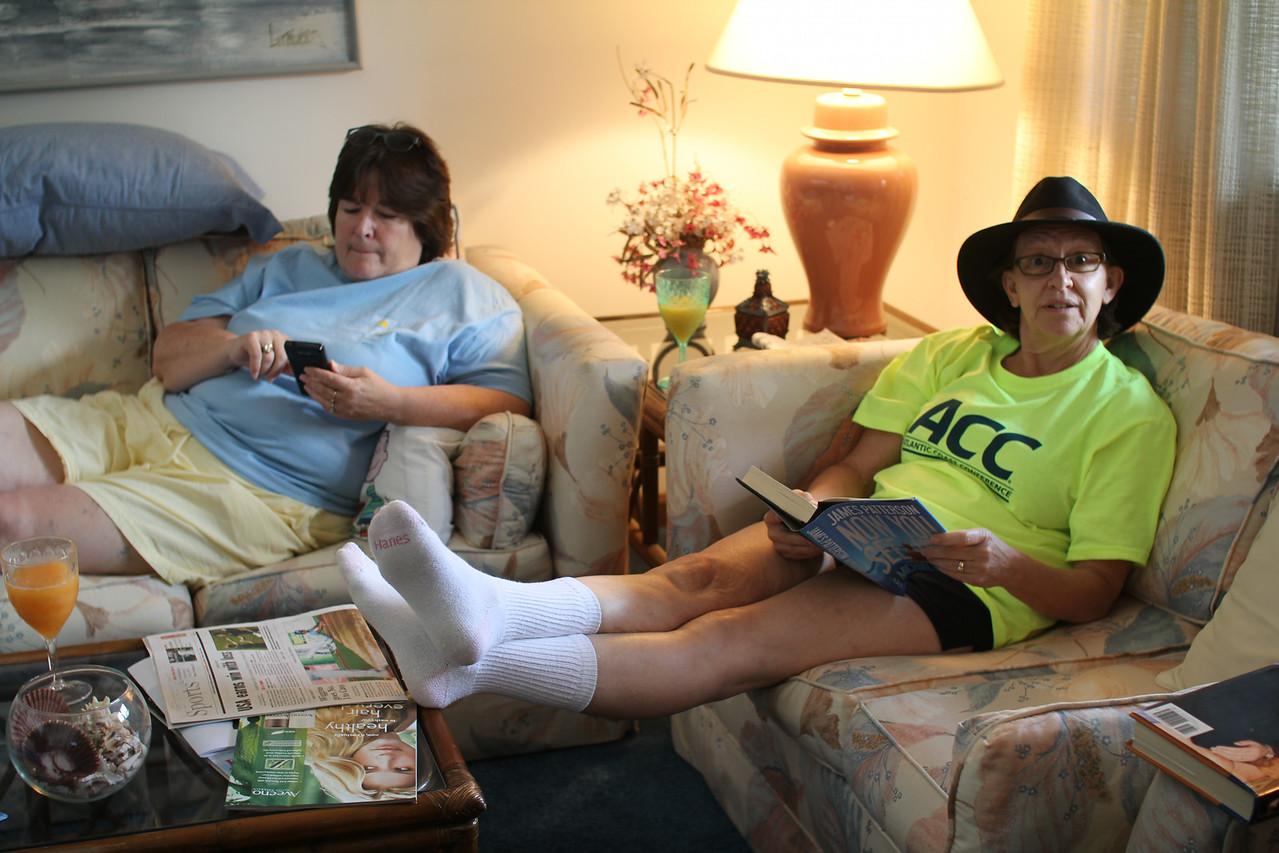 Marion pretending to read while wearing Melanie's socks