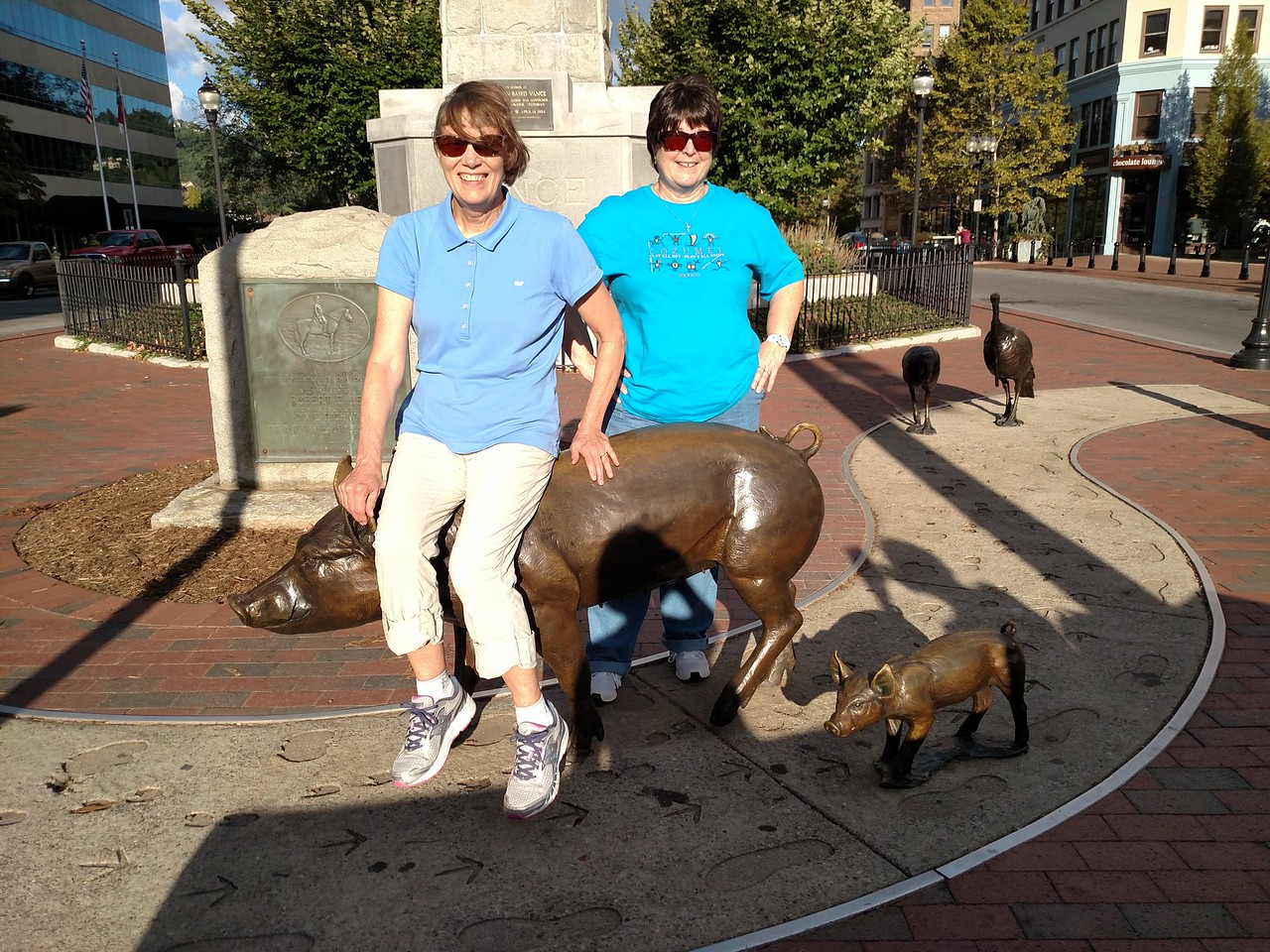 Fran & Joyce enjoy the pigs and turkeys in Pack Square
