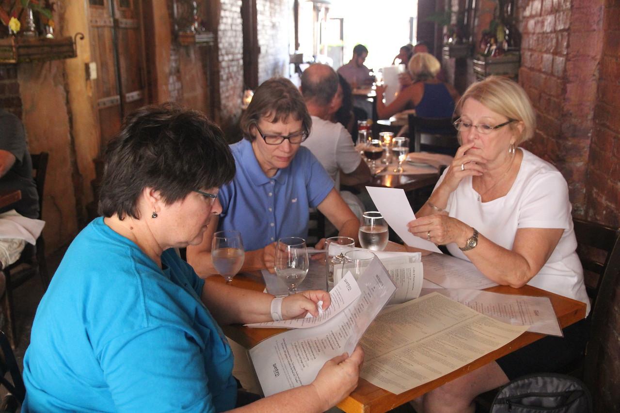 checking out the menu at Zambra Tapas Restaurant