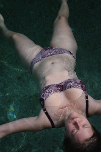Marikki playing by the pool at Lukes place. Photo by Trent Williams
