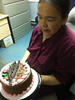 Mary Blueboy with cake in honour of 27 years of service at Keewaytinok Native Legal Services