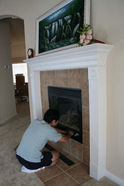 Oscar demonstrates the gas fireplace, that turns on with the flick of a switch.