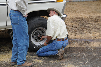 The cowboy was kind enough to pull the lug nuts off his own truck so we could have a wheel on the trailer.