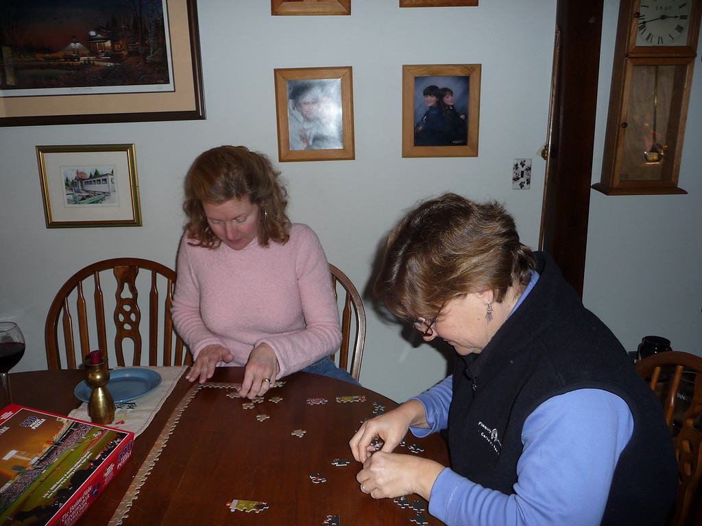 Gena and Suzy working on a puzzle.