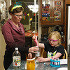 Laura helping Katie with chemistry experiments